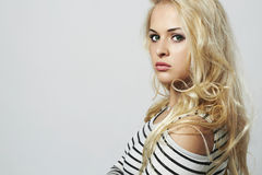 Beautiful woman. Curly hair. Beauty Blond Girl.your text here Royalty Free Stock Photography