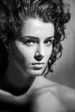 Beautiful woman with curly hair, black and white Stock Photography