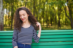 Beautiful woman with curly hair dreaming Stock Image