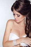 Beautiful woman with curly hair and evening make-up isolated on Stock Photography