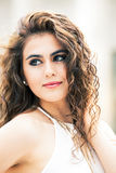 Beautiful woman with curly hair. Makeup Royalty Free Stock Image