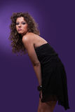 beautiful woman, with curly hair, on purple Royalty Free Stock Image