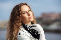 Beautiful woman with curly hairs Royalty Free Stock Photos