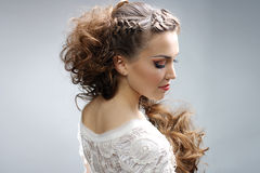 Beautiful woman with curly hairstyle royalty free stock images