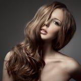 Beautiful Woman. Curly Long Hair Stock Photo