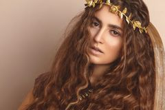 Free Beautiful Woman. Curly Long Hair. Fashion Model. Healthy Wavy Hairstyle. Accessories. Autumn Wreath, Gold Floral Crown Royalty Free Stock Photo - 129119655