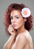 Beautiful woman with curly red hair Stock Photo