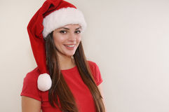Beautiful woman with cute smile in Santa hat happy for Christmas Stock Image
