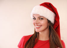 Beautiful woman with cute smile in Santa hat happy for Christmas Royalty Free Stock Image