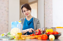 Beautiful woman cuts  pepper Stock Photo