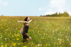 Beautiful woman cutting across a wildflower meadow Royalty Free Stock Photos