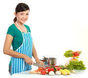 Beautiful woman cutting vegetables Royalty Free Stock Photography
