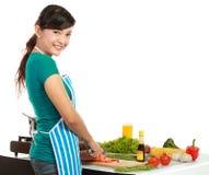 Beautiful woman cutting vegetables Stock Photos