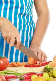 Beautiful woman cutting vegetables Royalty Free Stock Photo
