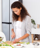 Beautiful woman cutting vegetables for her lunch Royalty Free Stock Photo