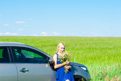 Beautiful woman with daisies in hands Royalty Free Stock Images