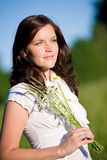 Beautiful woman with daisy flowers Stock Image