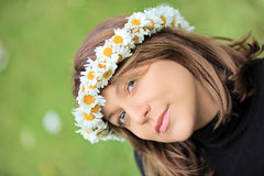 Beautiful woman with daisy hair wreath stock photos