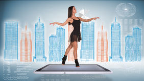 Beautiful woman dancer dancing on screen of tablet Stock Photography