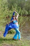 Beautiful woman dances on nature Arabic dances Royalty Free Stock Photo