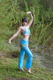 Beautiful woman dances on nature Arabic dances Stock Image