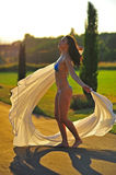 Beautiful woman dances under the sun Royalty Free Stock Photography
