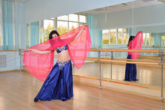 Beautiful woman dancing in arabic costume, oriental or belly dance Stock Photos