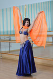 Beautiful woman dancing in arabic costume, oriental or belly dance Royalty Free Stock Photography