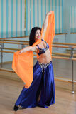 Beautiful woman dancing in arabic costume, oriental or belly dance Royalty Free Stock Images