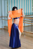 Beautiful woman dancing in arabic costume, oriental or belly dance Stock Photography