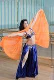Beautiful woman dancing in arabic costume, oriental or belly dance Royalty Free Stock Image