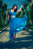 Beautiful woman dancing barefoot in a long blue dress Royalty Free Stock Photos