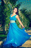Beautiful woman dancing barefoot in a long blue dress Royalty Free Stock Photo
