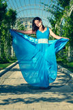 Beautiful woman dancing barefoot in a long blue dress Royalty Free Stock Photography