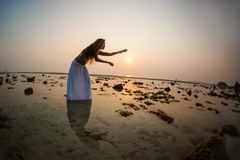 A beautiful woman dancing on the beach Royalty Free Stock Photography