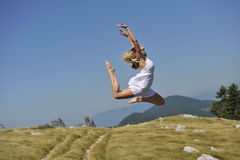 Beautiful woman dancing in nature Royalty Free Stock Image