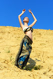 Beautiful woman dancing on the san� outdoors. Royalty Free Stock Image