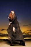 Beautiful woman dancing in the sundown stock images