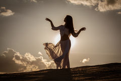Beautiful woman dancing at sunset Royalty Free Stock Images