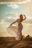 Beautiful woman dancing at sunset Stock Photos