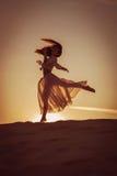 Beautiful woman dancing at sunset Royalty Free Stock Photo