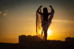 Beautiful woman dancing at sunset Stock Photography