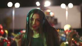 Beautiful woman dancing to the rhythm of music with headphones stock video footage