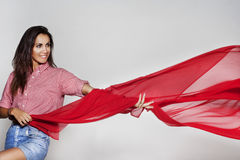 Beautiful woman dancing with waiving red fabric Royalty Free Stock Images
