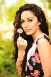 Beautiful woman with a dandelion Royalty Free Stock Photos