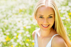 Beautiful woman among dandelions Royalty Free Stock Image