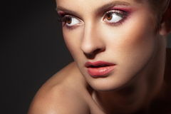 Beautiful woman on dark background Royalty Free Stock Images