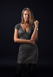 Beautiful woman on dark background Stock Photos