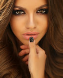 Beautiful woman with dark curly hair and bright makeup Stock Image