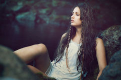 Beautiful woman in dark ethereal stream. Innocence concept Stock Images